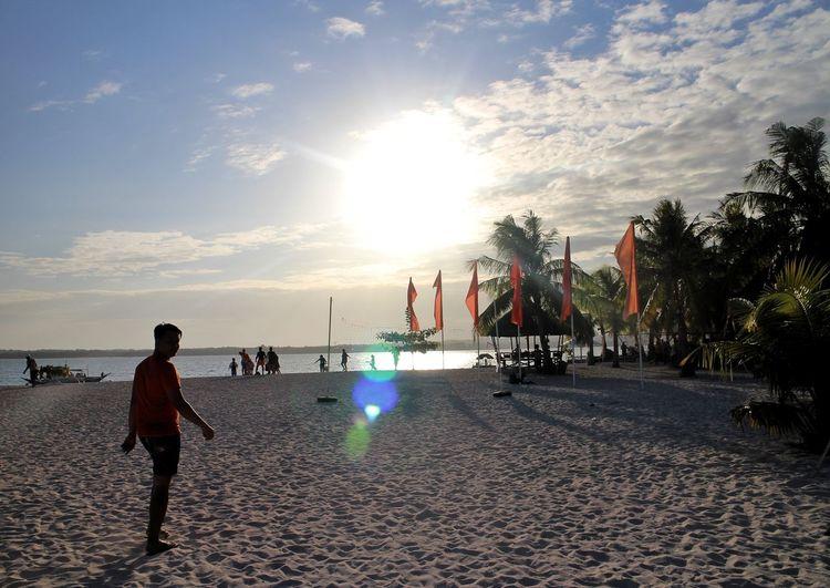 sunset by the beach Bantayan Island Bantayan Island, Cebu Northern Cebu Philippines Sunset Sunset By The Beach Silhouette Sunset Silhouette Man Silhouette Sand Beach Sand City Water Beach Women Arts Culture And Entertainment Summer Sea Men Crowd