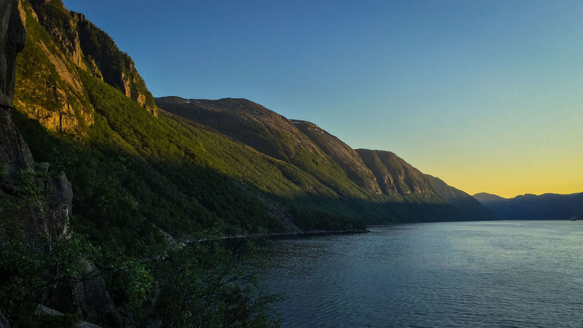 Sunset in the Lysefjord Beauty In Nature Clear Sky Day Fjord Idyllic Mountain Mountain Range Nature No People Outdoors River Scenics Sky Sunset Tranquil Scene Tranquility Travel Destinations Water Waterfront The Great Outdoors - 2017 EyeEm Awards Lost In The Landscape
