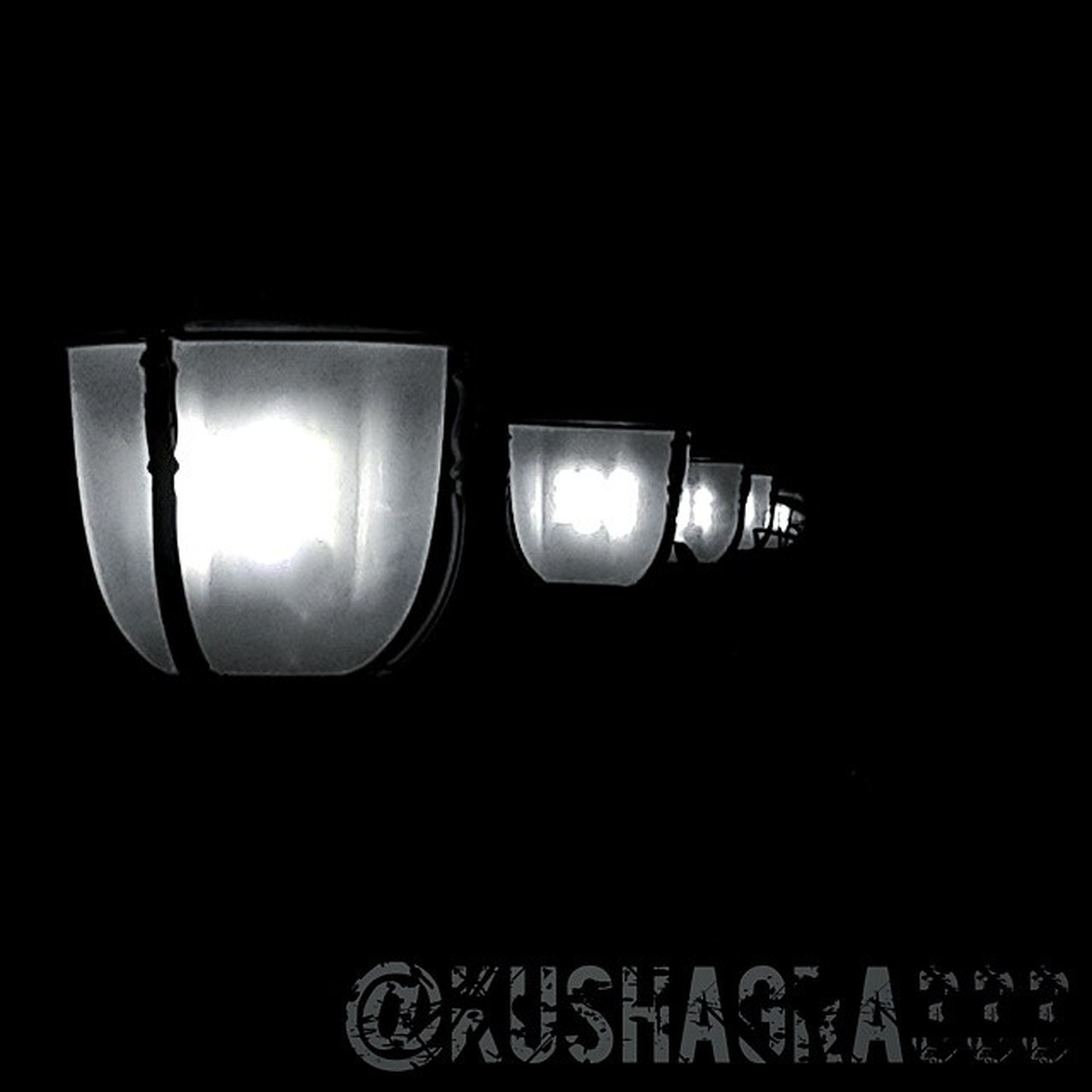 illuminated, copy space, lighting equipment, night, electricity, glowing, dark, low angle view, clear sky, electric light, street light, light bulb, light - natural phenomenon, indoors, glass - material, close-up, reflection, no people, technology, transportation