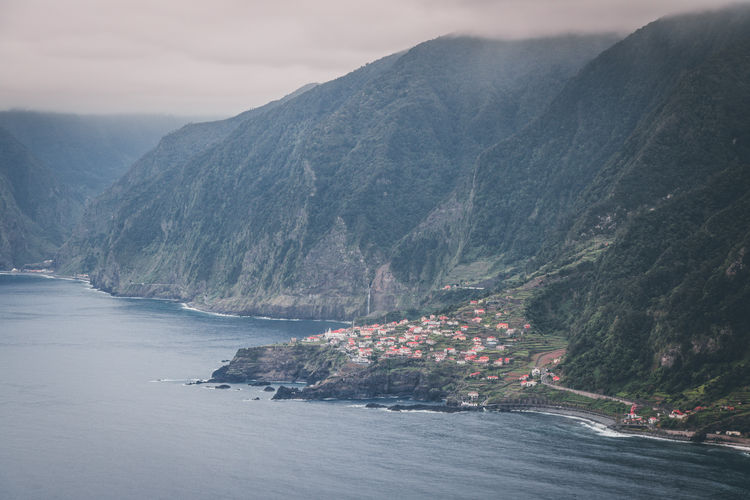 Mountain Water Scenics - Nature Beauty In Nature Tranquility No People Tranquil Scene Waterfront Sea Nature Sky Day Mountain Range Land Non-urban Scene Idyllic Outdoors Madeira Seixal Town By Sea Mountain View Mountain City Waterfall Coast Coastline My Best Photo