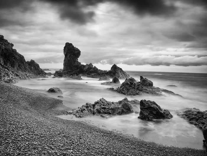 The black lava beach at Djupalonssandur, Iceland. The overcast day made the place feel even surreal. Sea Water Beauty In Nature Beach No People Travel Destinations Outdoors Travel Photography Nature Scenics Iceland Iceland_collection Day
