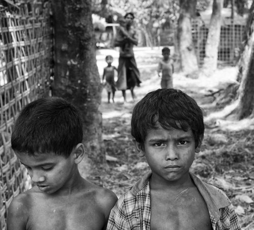 """Being a Rohingya"" photography project. The Rohingya community has been depicted as ""among the world's least wanted"" and ""one of the world's most persecuted minorities."" Archbishop Desmond Tutu has called the violence against Rohingya a ""slow genocide."" Despite deep concerns expressed recently by The Dalai Lama, President Barack Obama, the U.S. State Department and former Secretary of State Hillary Clinton and the recent country transition towards a more democratic government, the situation will not improve anytime soon. The Rohingya people have been my main motivation for a trip to Myanmar last April 2016. These pictures are rare. Few photographers accessed this area classified Red Zone. The Rakhine state has few visitors and limited touristic infrastructure. Check points installed around this community remind that the conflict is recent and the fear of new riots still subsists. During my trip I entered without official approval 3 Rohingya villages around Sittwe and Mrauk U. It enabled me to approach and engage with this hidden population ruled by terror. The purpose of these pictures is to increase the awareness and illustrate the humanitarian crisis of a country waiting for Rohingyas to disappear. Black & White Black And White Blackandwhite Burma Children Documentary Fear Genocide Human Condition Human Right Human Rights Minority Muslim Myanmar Oppression Photojournalism Population Poverty Red Zone  Rohingya Stateless Terror The Photojournalist - 2016 EyeEm Awards Unauthorized Village Life"
