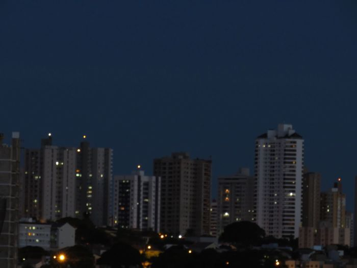 Low angle view of illuminated cityscape against sky