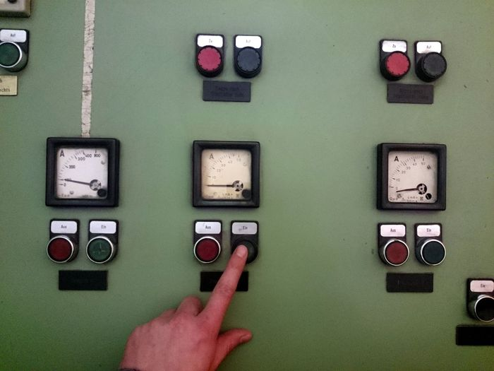 Cropped image of hand pressing push button