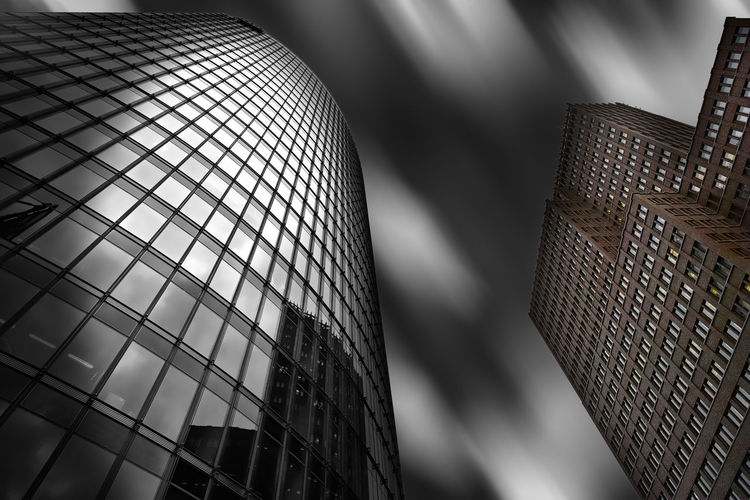 Bahn Tower in Potsdamer Platz, Berlin, by architect Helmut Jahn and the Kollhoff-Tower by Kollhoff und Timmermann Architekten Architecture B Bahn Tower Blackandwhite Clouds Kollhoff Tower Monochrome Skyscraper First Eyeem Photo