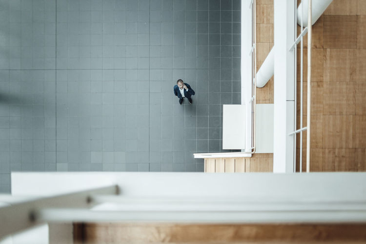 Midsection of woman on wall