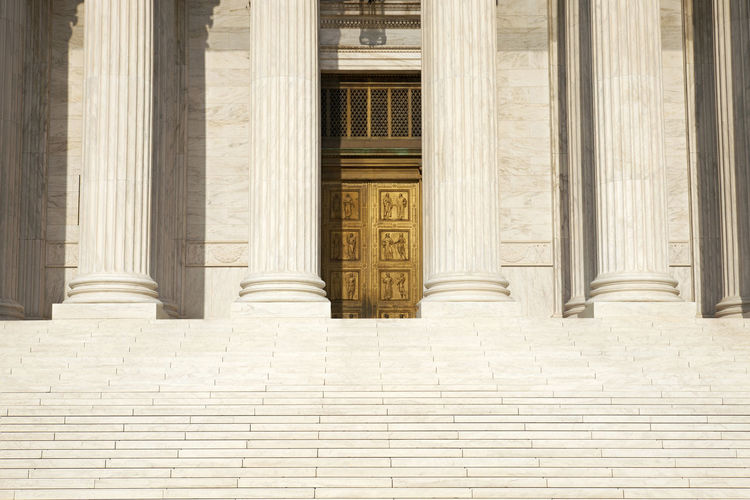 American Flag Architecture Bronze Building Columns Doors Exterior Historical Justice Law No People Sky Steps Supreme Court United States USA Washington, D. C. Washington, D.C.