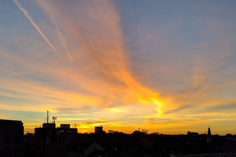 Krefeld Sunset in September Krefeld City Cityscape Urban Skyline Sunset Multi Colored Dramatic Sky Sky Architecture Building Exterior Romantic Sky Moody Sky Silhouette Cloud Scenics Tranquil Scene Evening Orange Color Atmospheric Mood Calm Tranquility Sky Only Cloudscape Wide Shot