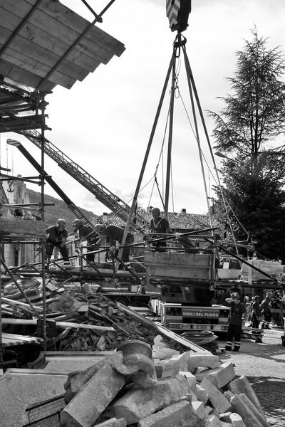 Firemen collect the rubble of the earthquake Abruzzo L'Aquila Rubble Wall Black And White Blackandwhite Construction Machinery Construction Site Crane Earthquake Earthquake In Italy Earthquake L'aquila Firemen Firemen At Work Italy Men Outdoors People Rubble Working