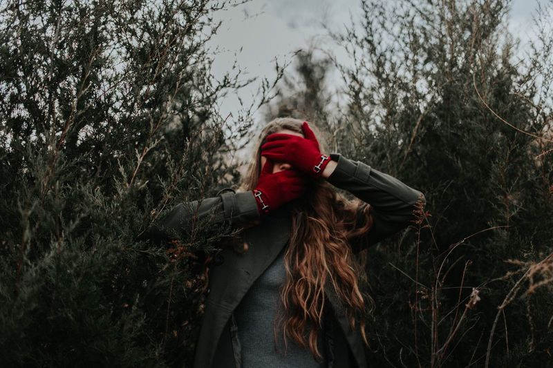 See no evil, speak no evil, but I can't help but hear what it's saying.. Christmas Red Portrait Moody Woman Tree Real People One Person Nature Red Outdoors EyeEm Ready   Day Lifestyles Forest Sky Warm Clothing People Young Adult
