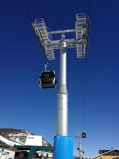 Blue Low Angle View Sky Clear Sky Nature Technology Day Sunlight Industry No People Cable Connection Outdoors Metal Lighting Equipment Electricity  Communication Security Camera Safety Power Supply Cableway Roccaraso Ski Area Ski Lift Gravare