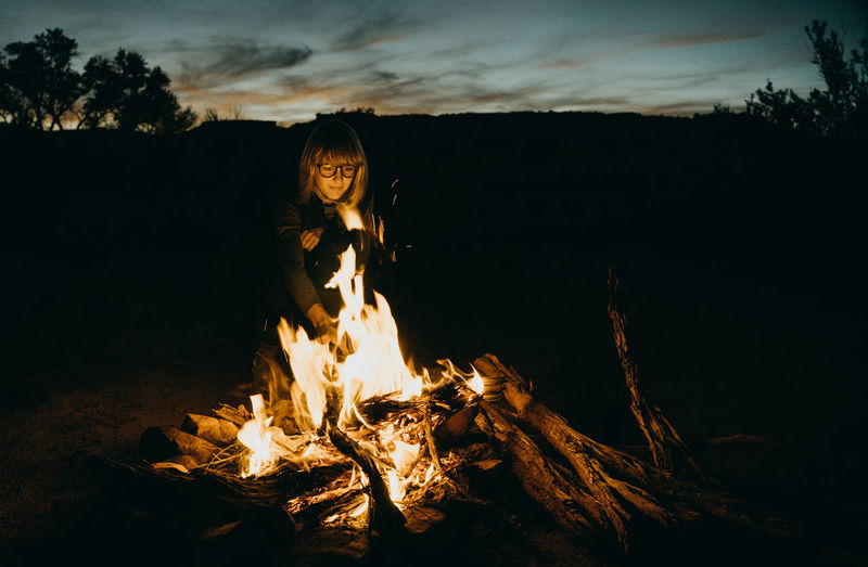 Night Fire Campfire Campfire In The Darkness Utah Woman With Fire Sky Nature Burning Real People Leisure Activity One Person Sunset Fire - Natural Phenomenon Field Bonfire Front View Cloud - Sky Lifestyles Flame Orange Color Land Tree Outdoors Wood Wild Camping Wood