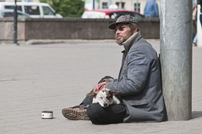 homeless man and dog sitting on the street Adult Adults Only Animal Animal Themes Day Dog Domestic Animals Editorial  Flat Cap Homless One Animal One Man Only One Mature Man Only One Person Outdoors People Pets Poverty Real Life Real People Candid Social Issues Street Photography Streetphotography Vet  EyeEm Diversity The Portraitist - 2017 EyeEm Awards
