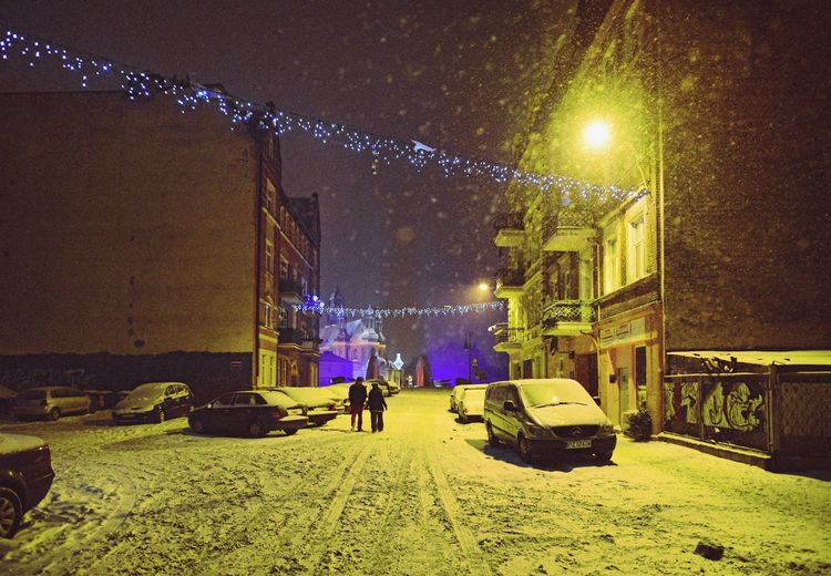Snowfall Street Night Illuminated Real People Mode Of Transport Land Vehicle Transportation Men Cold Temperature Snow Winter Mobility In Mega Cities