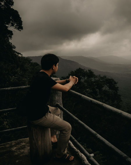 Side view of young man looking at view