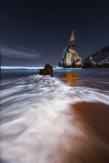 Sea Beach Long Exposure Landscape Scenics Wave Nature Outdoors No People Water Travel Destinations Night Sunset Beauty In Nature Low Tide Horizon Over Water Clear Sky Sky Ursa Beach Portugal Sintra Popular Beachphotography Beauty In Nature Wave