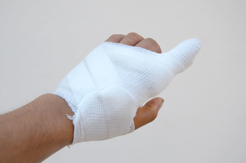 Adhesive Bandage Bandage Body Part Care First Aid Fracture Hand Healthcare And Medicine Human Body Part Human Foot Human Hand Human Limb Indoors  Medical Supplies Pain People Physical Injury Protection Recovery Security Studio Shot White Background Wound