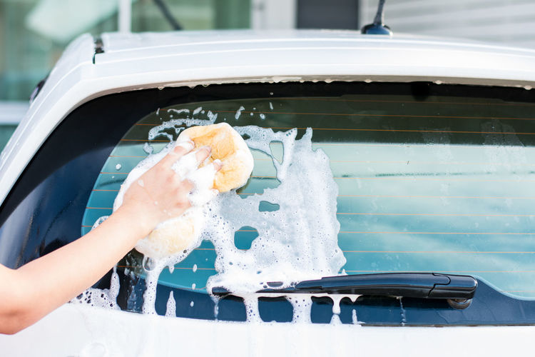 Car Washing. Car Washing Washing Car Day Finger Holding Human Body Part Human Hand Land Vehicle Lifestyles Mode Of Transportation Motor Vehicle