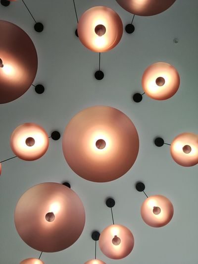 Illuminated pendant lights hanging from ceiling