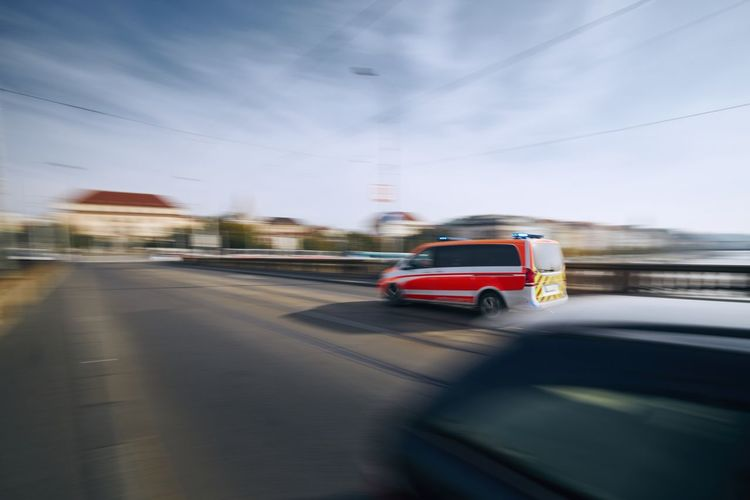 Car on road seen through windshield