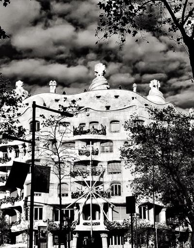 Architecture Gaudi #barcelona Casa Mila ( La Pedrera ) Built Structure Building Exterior Tree Sky Outdoors Travel Destinations Nikon Barcelona Streetphotography Monochrome Photography Noir Et Blanc Urban Photography Catalunya Lapedrera