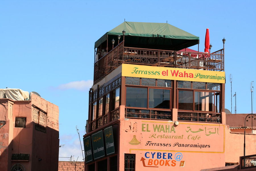 2011 Architecture Building Exterior Built Structure Communication Day Jamaa El Fna Marrakesh Morocco No People Outdoors Sky Text Western Script