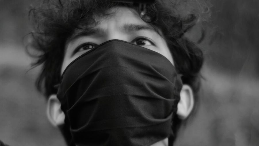 Close-up portrait of man covering face