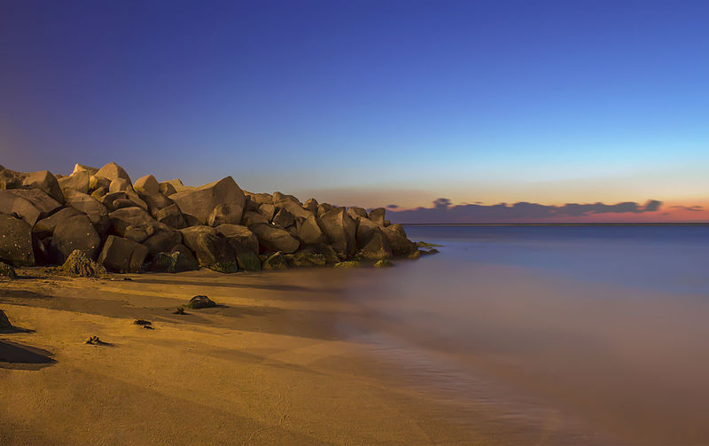 Beach Beach Beauty In Nature Clear Sky Horizon Over Water Landscape Nature Outdoors Rock - Object Sea Sky Sunset