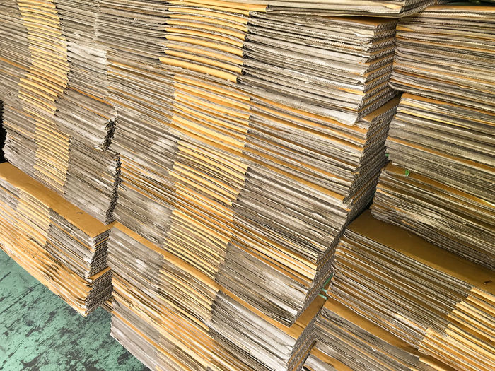 High angle view of cardboard sheets in warehouse