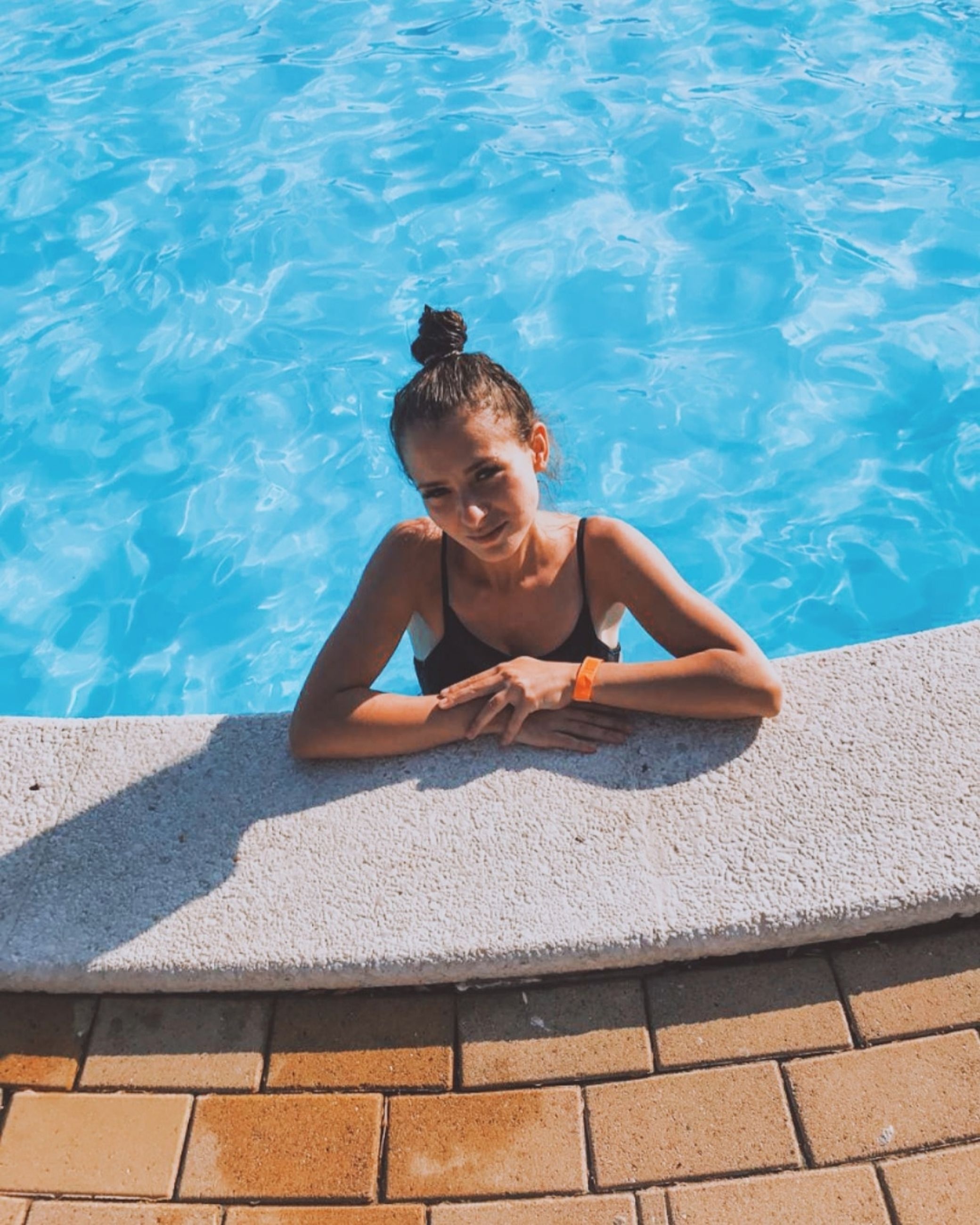 water, one person, leisure activity, high angle view, real people, lifestyles, nature, pool, child, sunlight, front view, swimming pool, day, childhood, swimwear, boys, portrait, outdoors