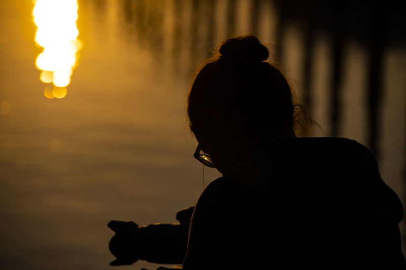 Woman with a photo camera taking pictures in the early morning