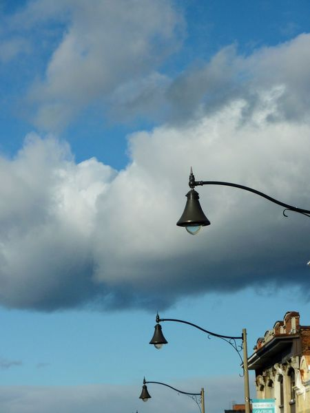 Lamp Posts Cloud - Sky Sky Travel No People Outdoors Vacations Day Business Finance And Industry Nature Aerobatics
