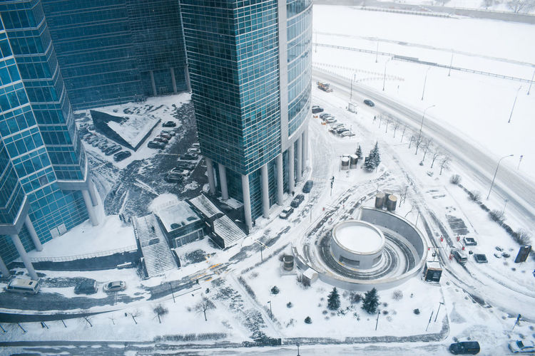 High angle view of modern buildings in city during winter