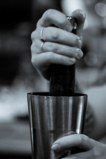 Cropped hands of woman holding mortar and pestle