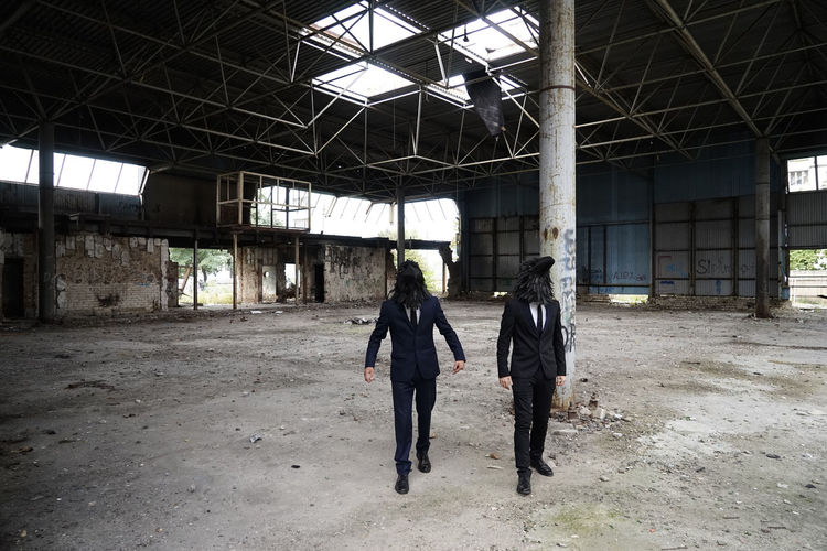 People standing in abandoned building