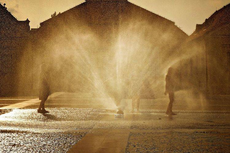 Backlight Childen Gold Silhouette Children At Play City Fountain Gold Colored Golden Hour Group Of People Motion People Play Play With Water Playing Real People Silouettes Street Water Summer In The City