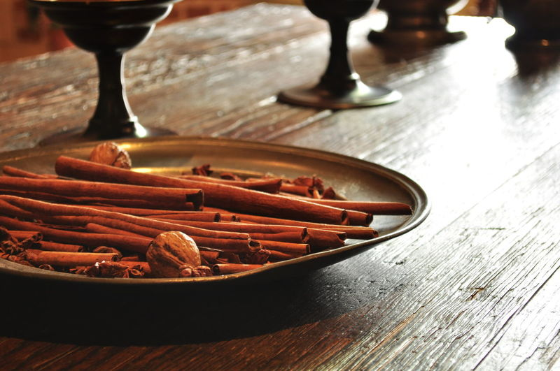 Close-up of cinnamon sticks in plate