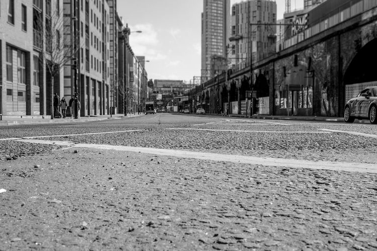 Architecture B&w Street Photography Building Work City Diminishing Perspective Incidental People Manchester Mouse Level Railway Viaduct Street Street Level Surface Level The Way Forward Vanishing Point Viaduct Welcome To Black