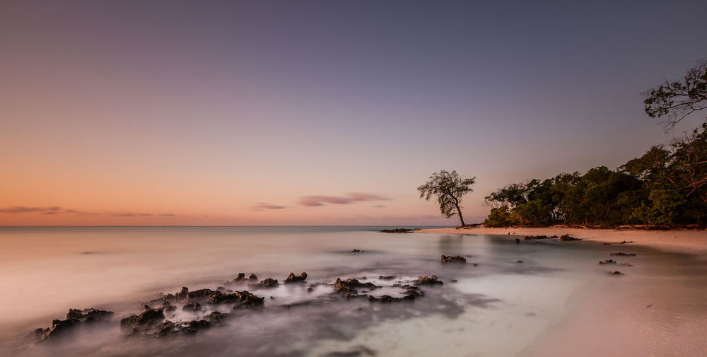 Serenity Africa; Mozambique Beauty In Nature Calm Clear Sky Coastal Feature Horizon Over Water Idyllic Majestic Nature No People Non-urban Scene Ocean Remote Rock - Object Scenics Sea Seascape Shore Sky Tranquil Scene Tranquility Tree Vacations Water Waterfront
