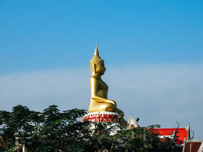 NongKhai,ThaiLand Architecture Blue Day Gold Colored Golden Color Human Representation Idol Low Angle View Male Likeness No People Outdoors Place Of Worship Religion Sculpture Sky Spirituality Statue Tree