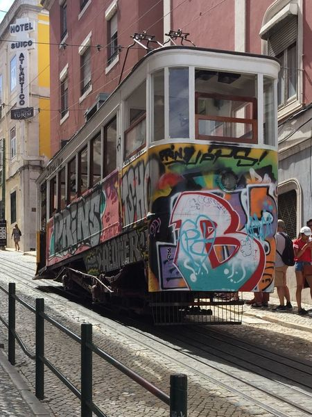 Built Structure Architecture Building Exterior Communication Text Outdoors Day No People City Close-up Sky tram Lisbon graffiti streetcar