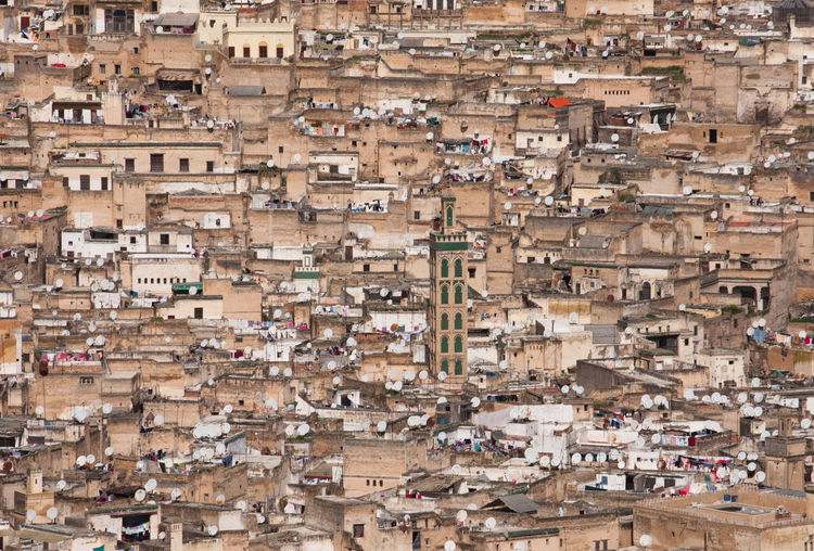 Oriental city: View from above on the houses of Fes, Morocco Architecture Building Exterior Building High Angle View Community Day Built Structure Town Travel Destinations Residential District Outdoors City Satellite Dish Festival Fes Morocco TOWNSCAPE