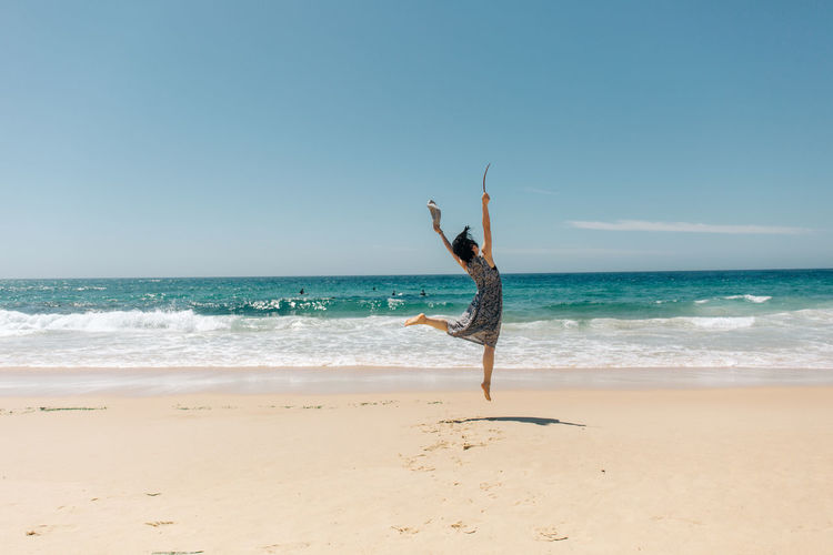 Sea Water Land Beach Sky Horizon Over Water Horizon Beauty In Nature Real People Scenics - Nature Clear Sky One Person Full Length Arms Raised Human Arm Nature Sand Motion Day Freedom Outdoors Travel People Portrait