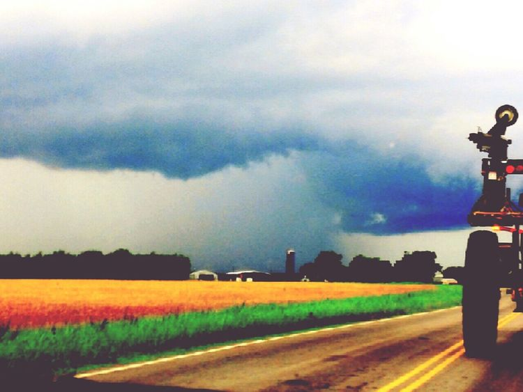 Thunderstorm Thunder Clouds Farm Tractor . Fence Ditch Tire Dark Clouds The Street Photographer - 2017 EyeEm Awards