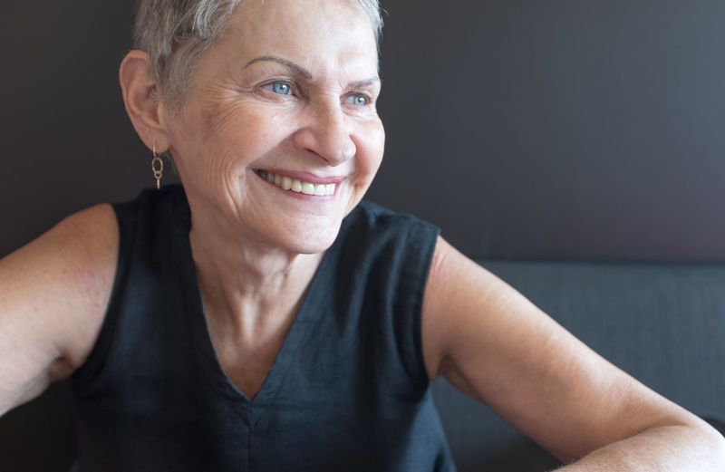 Beautiful older woman Portrait Smiling One Person Front View Headshot Indoors  Adult Casual Clothing Lifestyles Looking At Camera Women Happiness Real People Senior Adult Leisure Activity Senior Women Close-up Hairstyle Black Background
