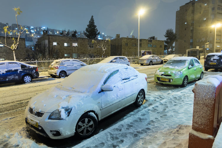 Cars on road in city during winter
