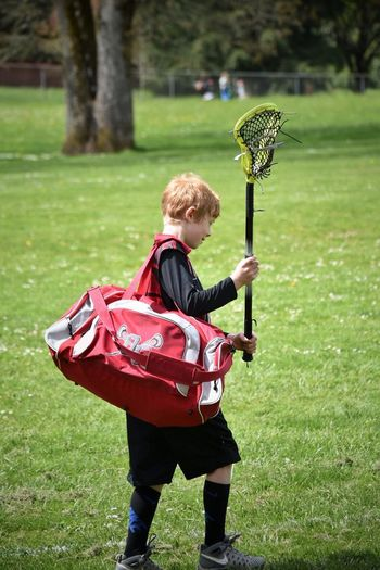 Child One Person Full Length Grass Sport Childhood Outdoors Boys Children Only People Day One Boy Only Nature Real People Soccer Field Adult The Great Outdoors - 2017 EyeEm Awards Sports Photography Lacrosse Youth Of Today Sports Children