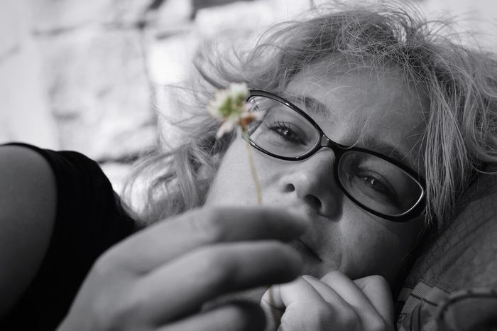 Outdoor Portrait Black & White Black And White Portrait Female Portraits Holding Flower Peaceful Moment Wearing Glasses Portrait Of A Woman Portrait Photography Peace Of Mind Mindfulness Relaxing Moments Relaxing The Portraitist - 2016 EyeEm Awards Natural Light Portrait