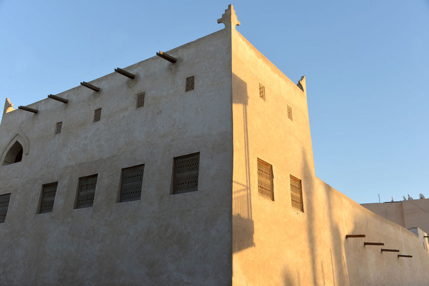 A newly-restored old house in Muharraq, Bahraion Architecture Blue Building Building Exterior Built Structure Clear Sky Day History Low Angle View Nature No People Old Outdoors Residential District Shadow Sky Sunlight The Past Wall Window