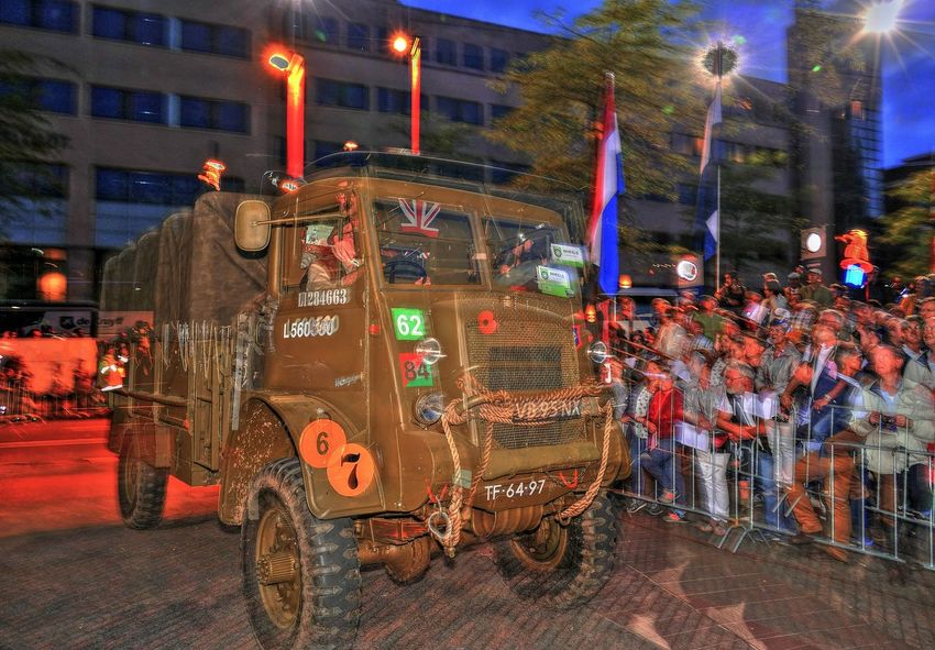 old army truck during defile Reenactment 18 September ♥ Army Army Truck Celebration City Commemorate Commémoration Defilé Eindhoven Illuminated Liberation Military Truck Movement Multi Colored Night Nightphotography Outdoors Parade People Street Photography Streetphotography Volonteer Ww2